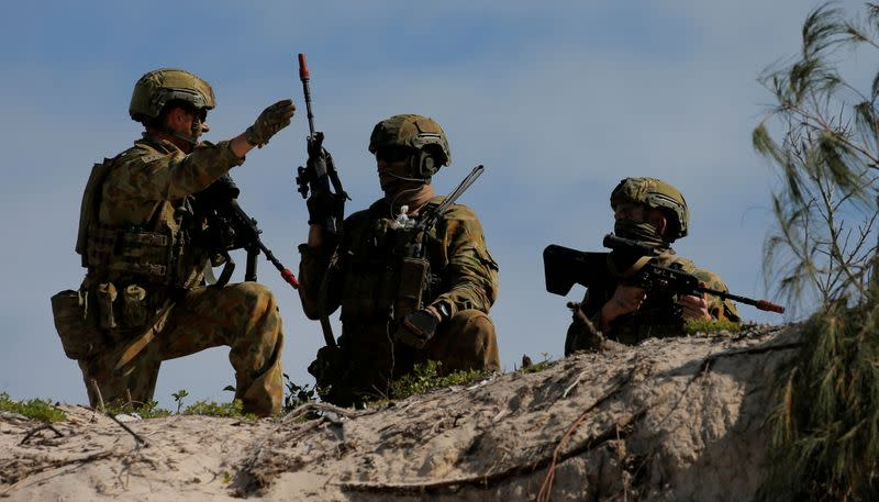 FILE PHOTO: Soldiers from the Australian Army's 3rd Brigade guard Langham Beach after an amphibious assault landing during the Talisman Saber joint military exercises between Australia and the United States in Queensland
