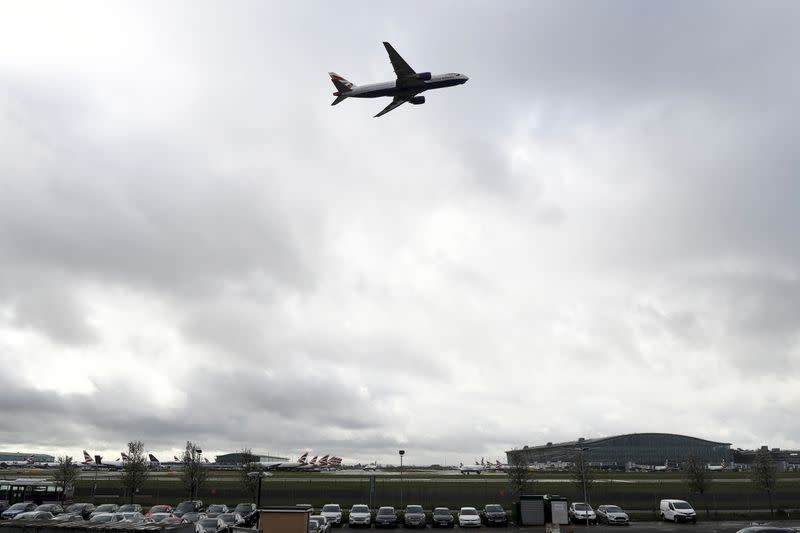 British Airways aircraft takes off over Terminal 5 at Heathrow Airport in London
