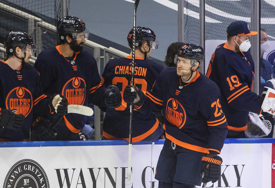 Edmonton Oilers' Leon Draisaitl (29) is congratulated for his goal against the Vancouver Canucks dduring the first period of an NHL hockey game Thursday, May, 6, 2021, in Edmonton, Alberta. (Jason Franson/The Canadian Press via AP)