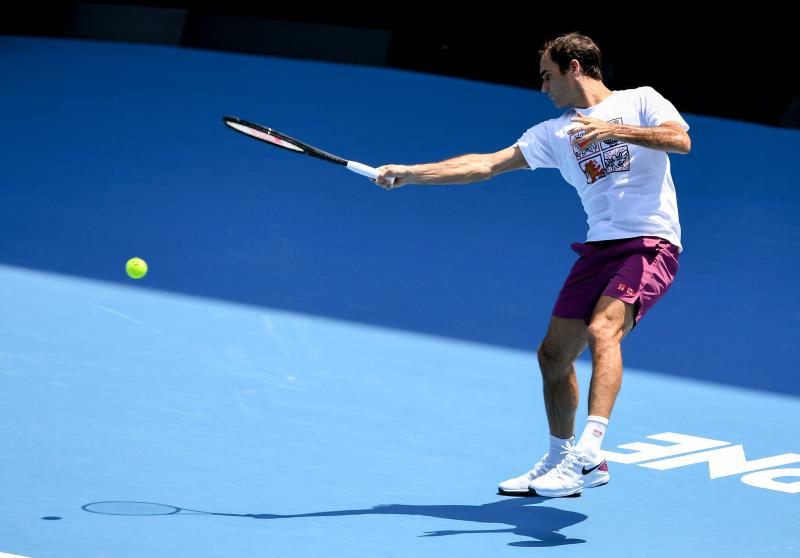 Roger Federer hits a return during a practice session ahead of the Australia Open tennis tournament in Melbourne on January 18, 2020. (Photo by William WEST / AFP)