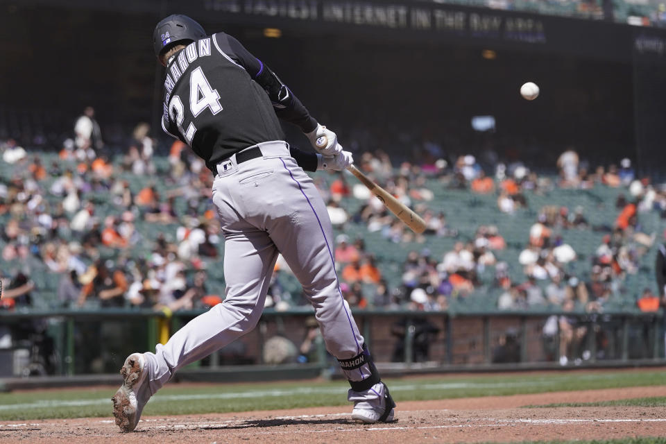 Colorado Rockies' Ryan McMahon (24) hits a two-run home run against the San Francisco Giants during the fifth inning of a baseball game in San Francisco, Saturday, April 10, 2021. (AP Photo/Jeff Chiu)