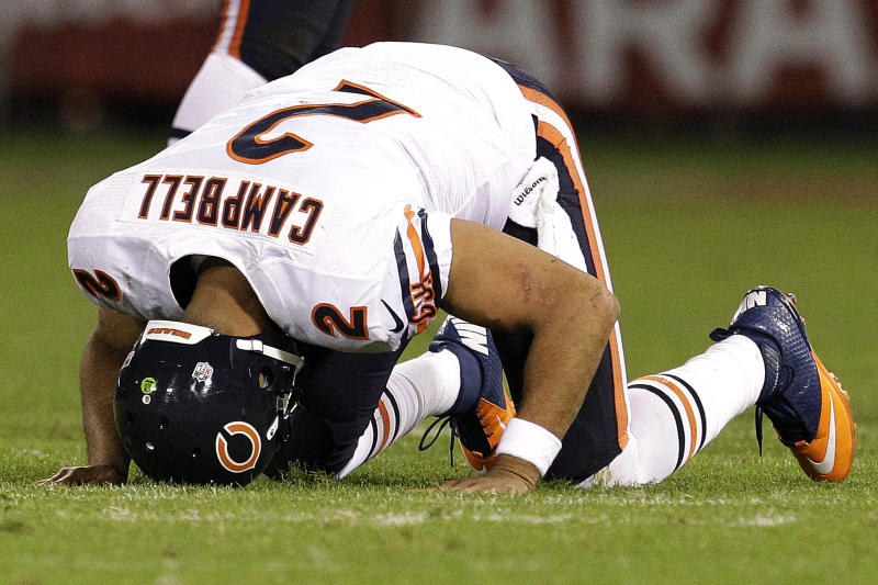 Chicago Bears quarterback Jason Campbell (2) gets off the ground after being tackled during the second half of an NFL football game against the San Francisco 49ers in San Francisco, Monday, Nov. 19, 2012. (AP Photo/Tony Avelar)