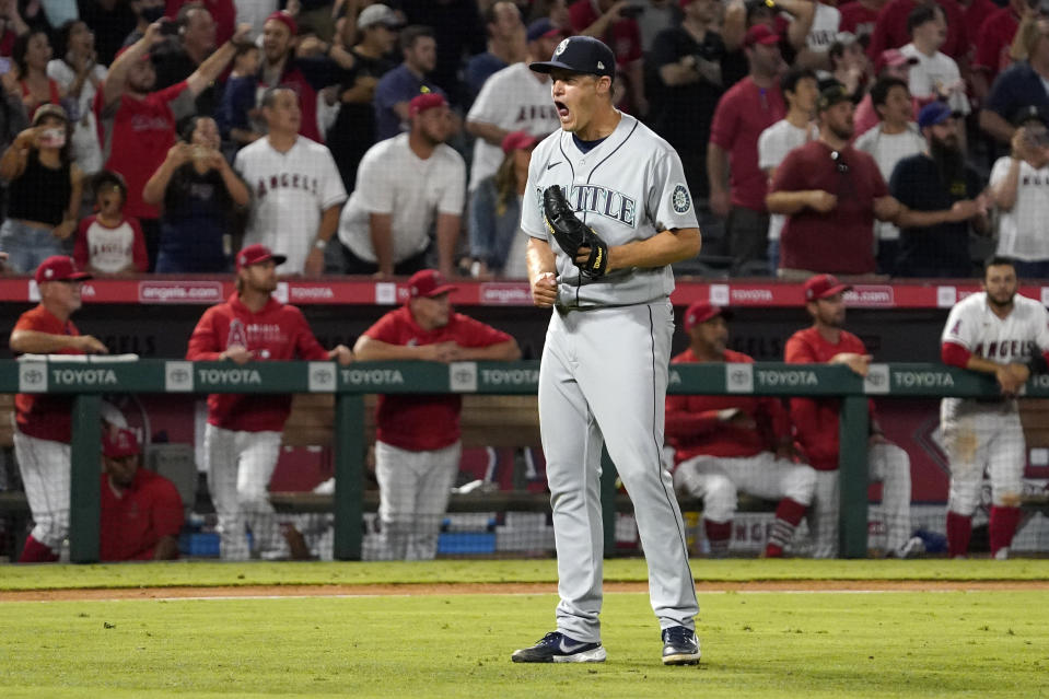 Seattle Mariners relief pitcher Paul Sewald celebrates as the final out is made to end their baseball game against the Los Angeles Angels Friday, July 16, 2021, in Anaheim, Calif. The Mariners won 6-5. (AP Photo/Mark J. Terrill)