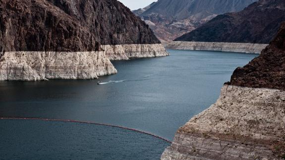 A ring of light-colored rock shows how much the water level has dropped at Nevada's Lake Mead.