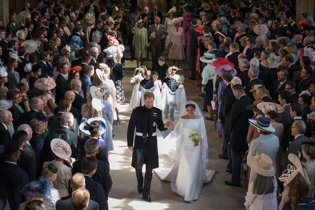 Prince Harry and Meghan Markle leave St George's Chapel at Windsor Castle after their wedding
