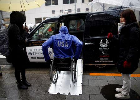 Paralympian Daniel Romanchuk of the U.S. enters a Toyota Motor Corp.'s JPN Taxi during his tour of Tokyo, Japan March 4, 2019.  REUTERS/Issei Kato