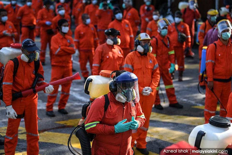 Firefighters wearing protective suits pray before a disinfection operation at Masjid Sri Petaling on Mar 28, 2020.<p><br></p>