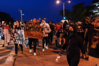 Protesters gather on the street Friday, Oct. 9, 2020, in Wauwatosa, Wis. On Wednesday, District Attorney John Chisholm refused to issue charges against Wauwatosa Police Officer Joseph Mensah for the Feb. 2 fatal shooting of 17-year-old Alvin Cole at Mayfair Mall. (AP Photo/Morry Gash)