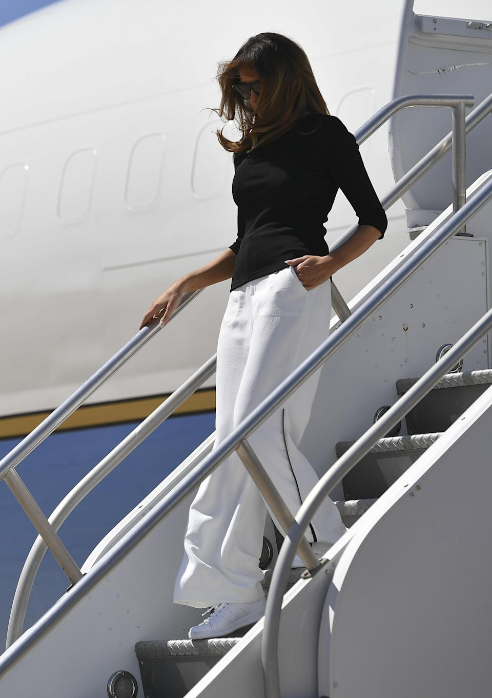 Trump traded her black flats for white sneakers. (Photo: Getty Images)