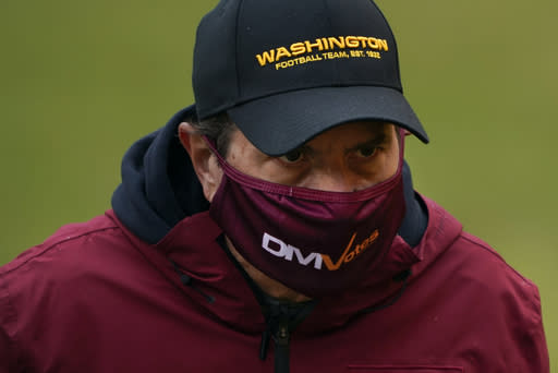 Washington Football Team owner Dan Snyder walks off the field before the start of an NFL football game against Dallas Cowboys, Sunday, Oct. 25, 2020, in Landover, Md. Washington has dumped its 86-year-old team name, handed over an investigation into workplace misconduct to the NFL, seen minority owners and Dan Snyder battle it out in court, coach Ron Rivera battle a form of skin cancer and reached the playoffs on the arm of a quarterback who hadnt played in two years because of an injury that looked career-threatening. All in a few months work for arguably the biggest soap opera in professional sports with a playoff game against Tom Brady up next. (AP Photo/Susan Walsh, File)