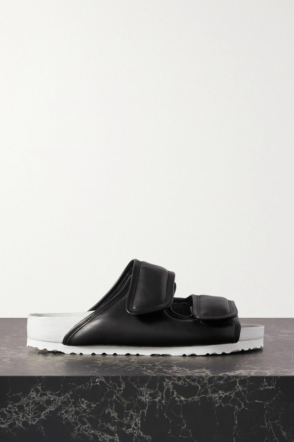 """<p><strong>Birkenstock 1774</strong></p><p>net-a-porter.com</p><p><strong>$470.00</strong></p><p><a href=""""https://go.redirectingat.com?id=74968X1596630&url=https%3A%2F%2Fwww.net-a-porter.com%2Fen-us%2Fshop%2Fproduct%2Fbirkenstock-1774%2Fshoes%2Fflat%2Fplus-ding-yun-zhang-two-tone-padded-leather-sandals%2F2009602587198&sref=https%3A%2F%2Fwww.harpersbazaar.com%2Ffashion%2Ftrends%2Fg37039475%2Fgifts-for-new-moms%2F"""" rel=""""nofollow noopener"""" target=""""_blank"""" data-ylk=""""slk:Shop Now"""" class=""""link rapid-noclick-resp"""">Shop Now</a></p><p>Get her some shoes that are cool, but feel like slippers, but are definitely not actually slippers.</p>"""
