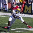 Michigan defensive back Brad Hawkins (20) reaches out for the ball intended for Indiana wide receiver Miles Marshall (13) during the first half of an NCAA college football game Saturday, Nov. 7, 2020, in Bloomington, Ind. (AP Photo/Doug McSchooler)