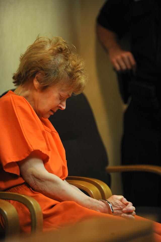 Sandra Layne, 74, appears in handcuffs at the 48th District Count in Bloomfield Hills, Mich., Monday, May 21, 2012. Layne has been charged with open murder in the shooting death of her 17-year-old grandson in the suburban Detroit condo they shared. (AP Photo/The Detroit News, Max Ortiz)