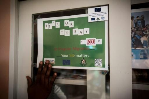A sign that is part of a campaign to stop illegal migration from Ghana to Libya and Europe and to promote safe migration reads 'It's okay to say no to irregular migration'