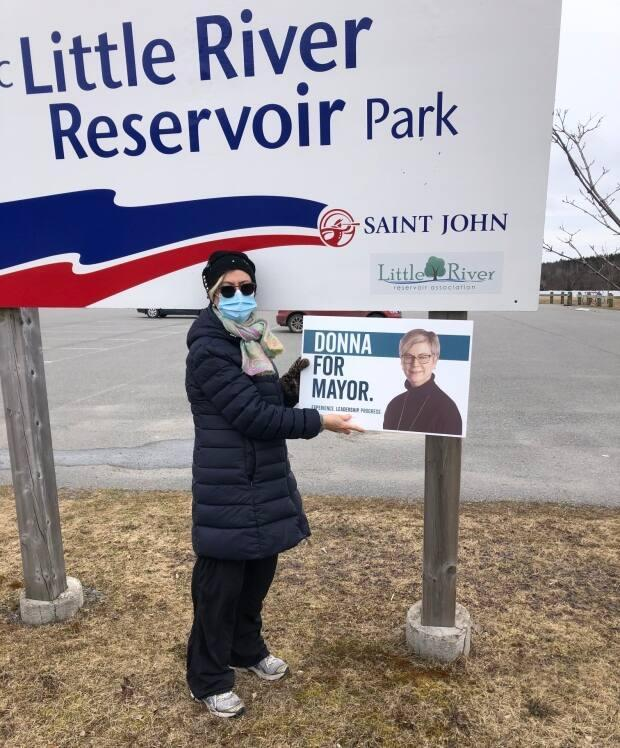 Due to the pandemic, Saint John mayoral candidate Donna Reardon has been walking around the city with a campaign sign instead of knocking on doors.
