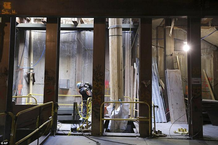 """At work on the Second Avenue subway line. Horodniceanu told the <a href=""""http://www.dailymail.co.uk/news/article-2275380/New-York-City-expanding-nations-biggest-transit-hub-16-stories-beneath-Grand-Central-Terminal.html#ixzz2KKzbdozl """" rel=""""nofollow noopener"""" target=""""_blank"""" data-ylk=""""slk:Daily Mail"""" class=""""link rapid-noclick-resp"""">Daily Mail</a> that creating the Second Avenue line will """"Decongest and reallocate and allow people to travel in a more humane fashion. Today they are basically sardines lined with oil."""" (Photo/ AP)"""