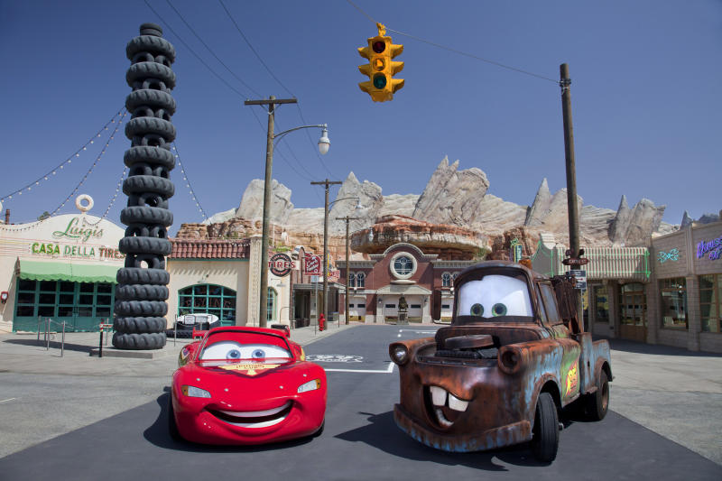 "This May 2012 photo released by Disneyland shows characters Lightning McQueen, left, and Mater at the new 12-acre Cars Land, a replica of Radiator Springs, the town in the popular ""Cars,"" film franchise at Disney California Adventure park at Disneyland Resort in Anaheim, Calif. The park's five-year, $1 billion-plus revamp has debuted in spurts since 2008. Most of its new features rely on characters that come from Disney's $7.4 billion acquisition of Pixar Animation Studios, the San Francisco-area studio behind ""Cars,"" `'Toy Story,"" `'Monsters Inc."" and ""A Bug's Life."" (AP Photo/Disneyland Resort, Paul Hiffmeyer)"