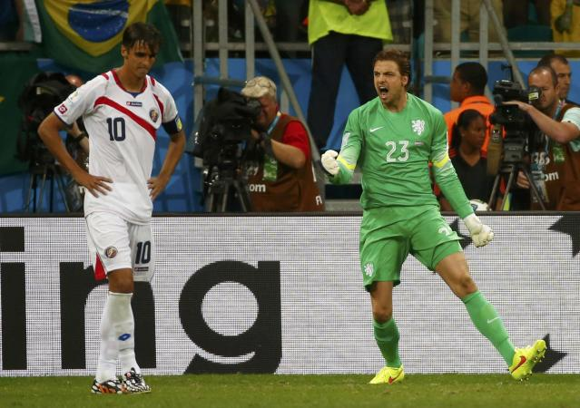 Goalkeeper Tim Krul (R) of the Netherlands celebrates saving a shot by Costa Rica's Bryan Ruiz during a penalty shootout in their 2014 World Cup quarter-finals at the Fonte Nova arena in Salvador July 5, 2014. REUTERS/Michael Dalder (BRAZIL - Tags: SOCCER SPORT WORLD CUP TPX IMAGES OF THE DAY)