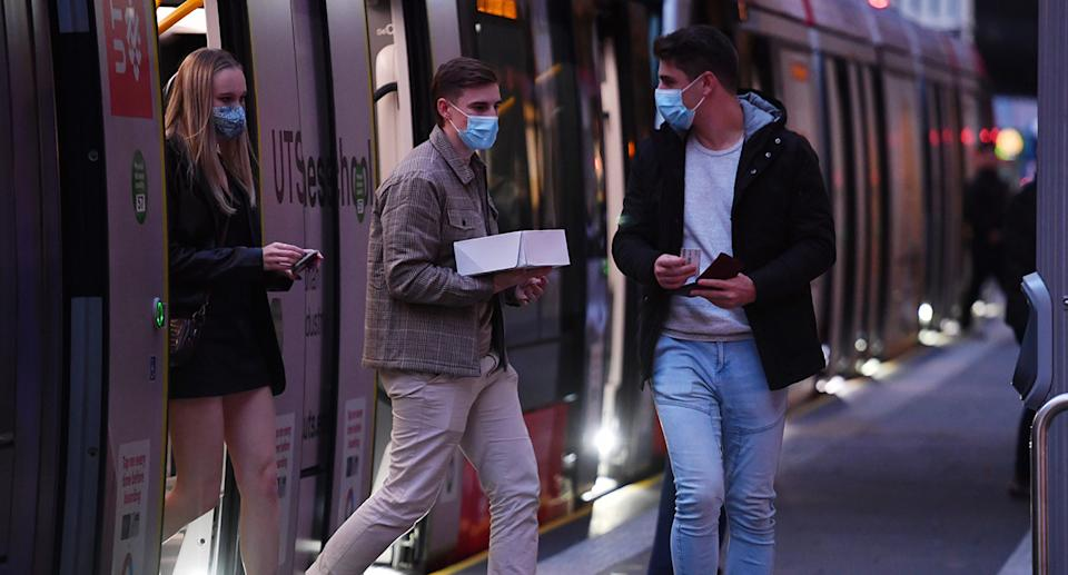 The wearing of face masks on public transport has been made compulsory as health authorities scramble to contain the new COVID-19 outbreak. Source: AAP