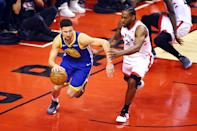 Klay Thompson #11 of the Golden State Warriors is defended by Kawhi Leonard #2 of the Toronto Raptors in the first half during Game Five of the 2019 NBA Finals at Scotiabank Arena on June 10, 2019 in Toronto, Canada. (Photo by Vaughn Ridley/Getty Images)