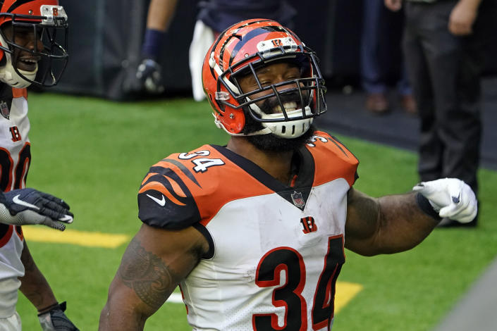 Cincinnati Bengals running back Samaje Perine (34) celebrates after a 46-yard touchdown run against the Houston Texans during the second half of an NFL football game Sunday, Dec. 27, 2020, in Houston. (AP Photo/Sam Craft)