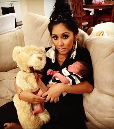 "Snooki wrote about her weight loss on Twitter recently, crediting it to her breastfeeding her son. ""I've lost a lot of my baby weight! Also it's the best for him!"""