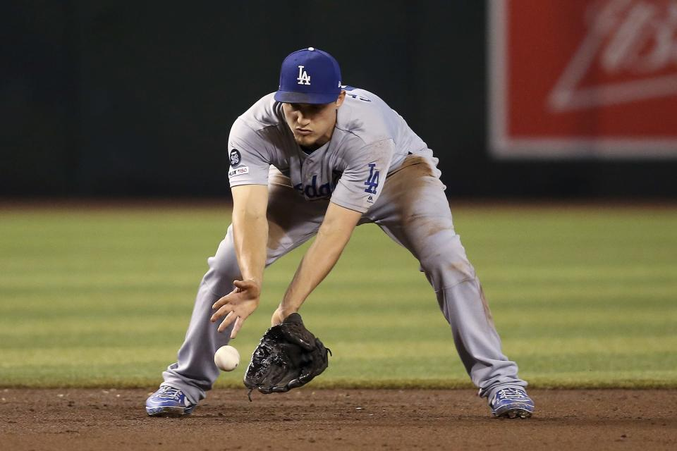 Los Angeles Dodgers shortstop Corey Seager fields a grounder hit by Arizona Diamondbacks' Adam Jones before throwing to first base for the out during the second inning of a baseball game Friday, Aug. 30, 2019, in Phoenix. (AP Photo/Ross D. Franklin)