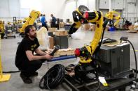 An inventory of manufacturing robots waiting to be shipped to customers are seen in a FANUC American facility