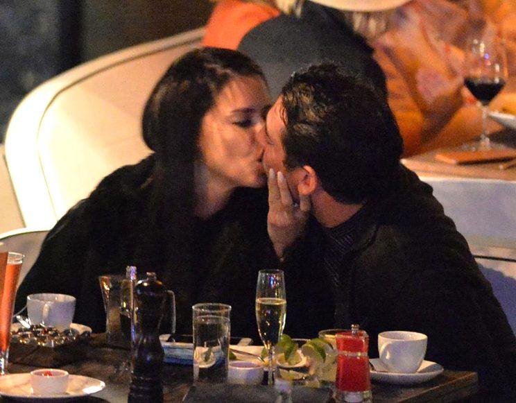 Lima and Harvey puckered up in between sips of champagne during dinner in Miami Wednesday night. (Photo: Instarimages.com)