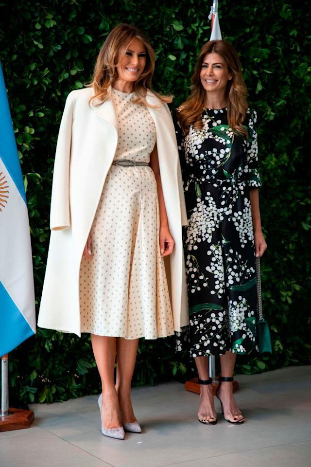<p>Melania wore a white dress with polka dots while posing for a photo with Argentina's First Lady Juliana Awada. She paired the dress with a long white coat and heels. </p>