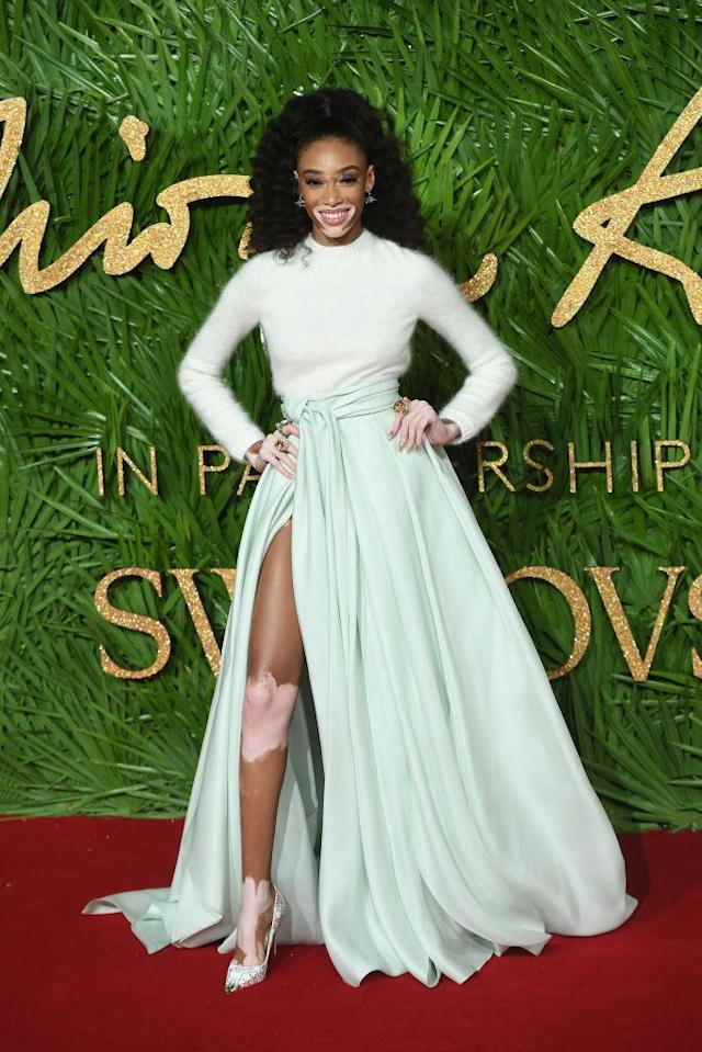 <p>Winnie Harlow made a case for winter blues in a fluffy knit and thigh-split skirt. (Photo: Getty Images) </p>