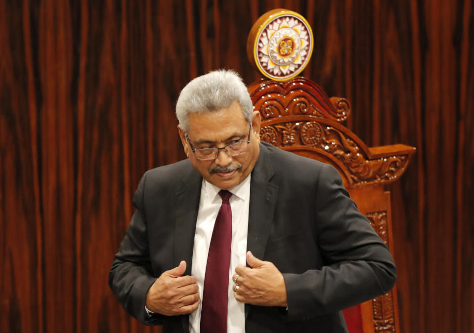 FILE - In this Jan. 3, 2020, file photo, Sri Lankan President Gotabaya Rajapaksa leaves after addressing parliament during the ceremonial inauguration of the session, in Colombo, Sri Lanka. A proposed amendment to Sri Lanka's constitution that will consolidate powers in the President's hands has raised concerns about the independence of the country's institutions and the impact on its ethnic minorities who fear their rights could be undermined by the majoritarian will.(AP Photo/Eranga Jayawardena, File)