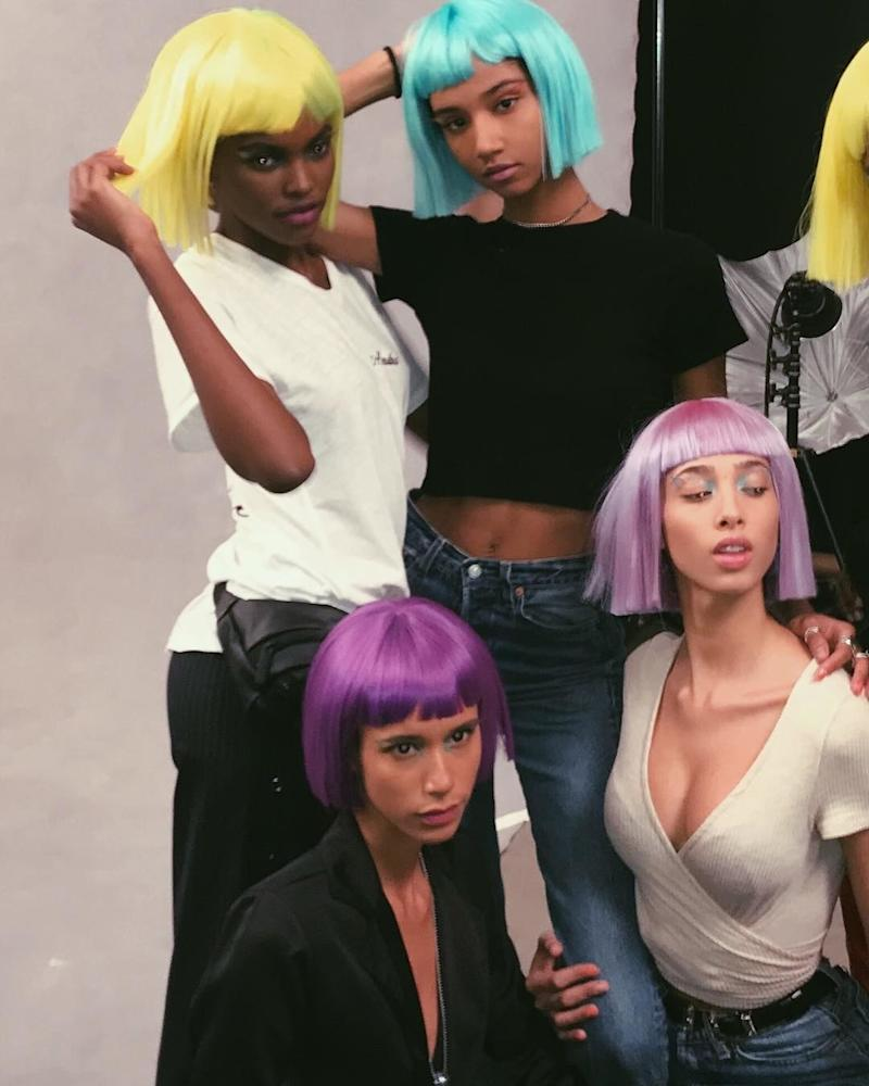 Model Yasmin Wijnaldum and friends pose backstage at the Jeremy Scott show flaunting their neon colored wigs.