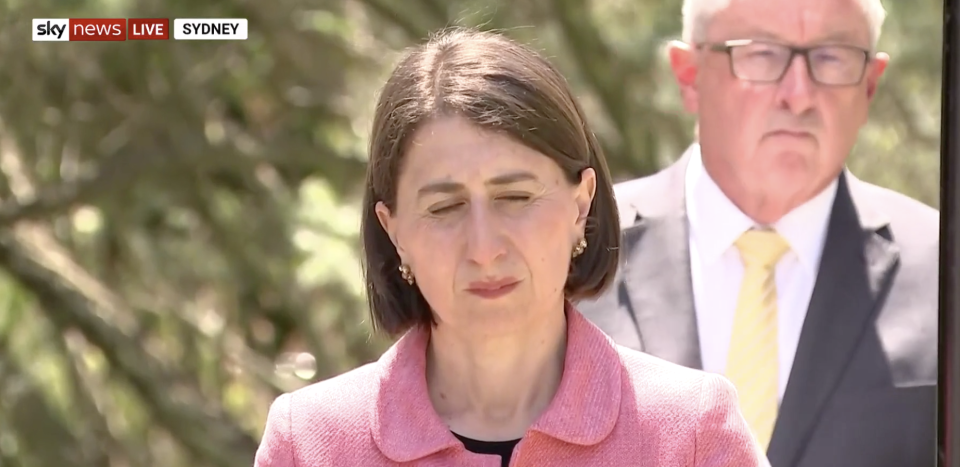Pictured is Gladys Berejiklian blinking during a press conference.
