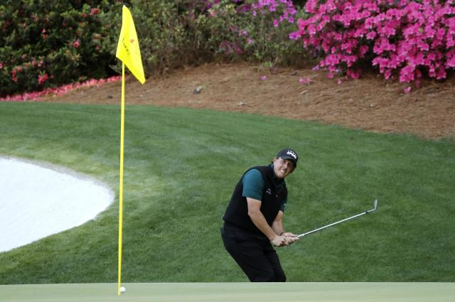 Phil Mickelson of the U.S. reacts after missing a putt on the 13th hole during first round play of the 2018 Masters golf tournament at the Augusta National Golf Club in Augusta, Georgia, U.S., April 5, 2018. REUTERS/Mike Segar