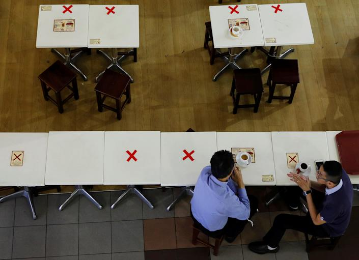 Diners keep their social distance at a cafe during the coronavirus disease (COVID-19) outbreak in Singapore September 7, 2021. REUTERS/Edgar Su