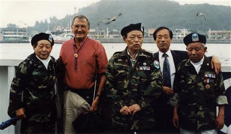 Merrill Edward Newman poses for group photo with former Kuwol Guerrilla Unit members at a port in Incheon, west of Seoul