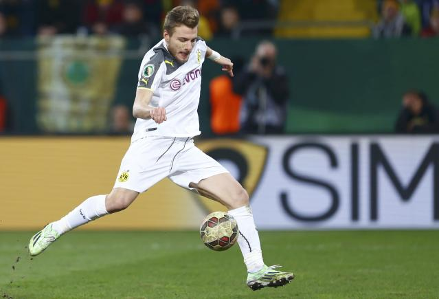 Borussia Dortmund's Italian striker Ciro Immobile scores a goal against Dynamo Dresden during German Cup (DFB Pokal) soccer match against in Dresden March 3, 2015. REUTERS/Hannibal Hanschke (GERMANY - Tags: SOCCER SPORT) DFB RULES PROHIBIT USE IN MMS SERVICES VIA HANDHELD DEVICES UNTIL TWO HOURS AFTER A MATCH AND ANY USAGE ON INTERNET OR ONLINE MEDIA SIMULATING VIDEO FOOTAGE DURING THE MATCH.