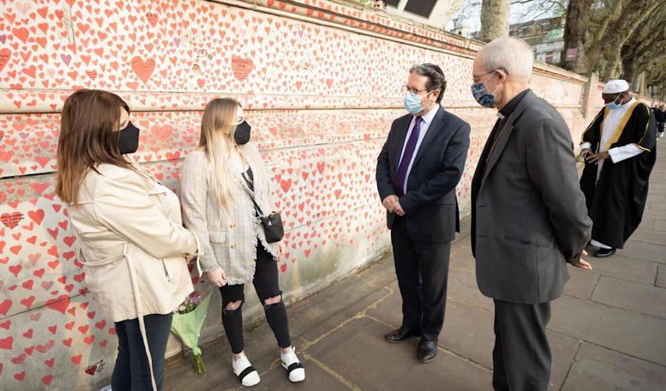 Rabbi Daniel Epstein and archbishop of Canterbury Justin Welby with surviving relatives Michelle and Courtney Rumball.