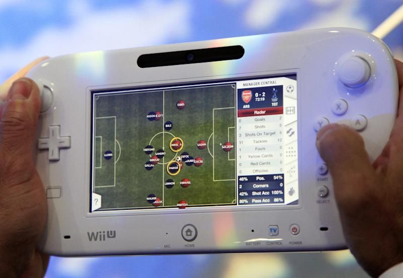 Nintendo's Wii U GamePad is unveiled, Thursday, Sept. 13, 2012 in New York. The gaming console will start at $300 and go on sale in the U.S. on Nov. 18, in time for the holidays, the company said Thursday. (AP Photo/Mark Lennihan)