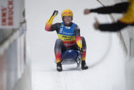 Felix Loch of Germany celebrates after his 2nd run during the Luge World Cup event in Innsbruck, Austria, Saturday, Jan. 23, 2021. (AP Photo/Andreas Schaad)