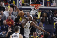 Los Angeles Clippers forward Paul George (13) shoots over Indiana Pacers' Myles Turner (33) during the second half of an NBA basketball game, Monday, Dec. 9, 2019, in Indianapolis. The Clippers won 110-99. (AP Photo/Darron Cummings)
