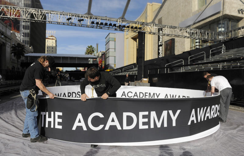 Workers assemble signage for a truss that will hang over the red carpet at Sunday's 84th Academy Awards in the Hollywood section of Los Angeles, Wednesday, Feb. 22, 2012. (AP Photo/Chris Pizzello)