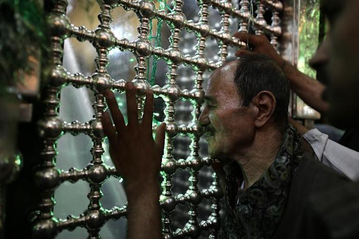 In this Tuesday, June 4, 2013 photo, an Egyptian man prays at the Sayyeda Zeinab shrine, sister of Imam Hussein, the grandson of Islam's prophet Muhammad and one of the most believed Shiite saints, in Cairo, Egypt. Hatreds between Shiites and Sunnis are now more virulent than ever in the Arab world because of Syria's brutal civil war. Hard-line clerics and politicians on both sides have added fuel, depicting the fight as essentially a war of survival for their sect. (AP Photo/Hassan Ammar)