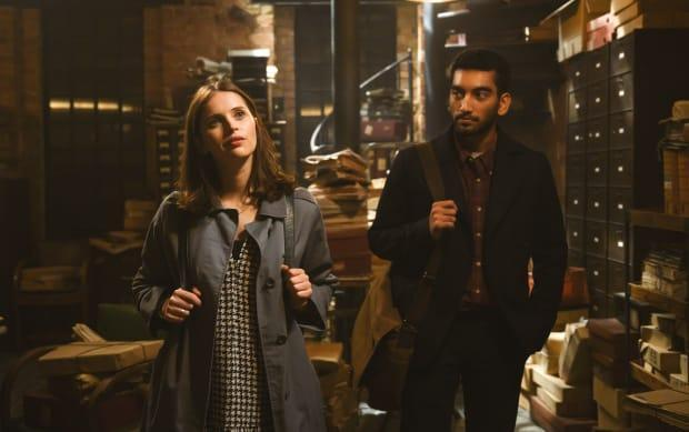 Ellie (Felicity Jones), in Jennifer-reminiscent houndstooth and '60s Burberry jacket, and Rory (Nabhaan Rizwan).<p>Photo: Parisa Taghizadeh/Courtesy of Netflix</p>