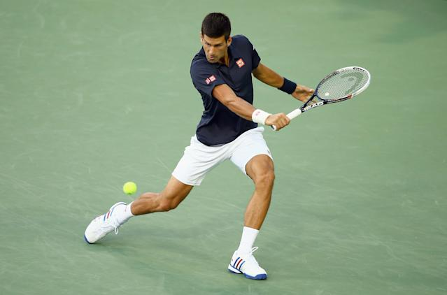 Novak Djokovic of Serbia hits a return to Gilles Simon of France during the Western & Southern Open, at the Lender Family Tennis Center in Cincinnati, Ohio, on August 12, 2014 (AFP Photo/Andy Lyons)