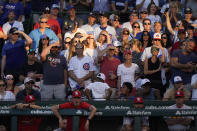 Fans watch a baseball game between the St. Louis Cardinals and the Chicago Cubs during the seventh inning in Chicago, Sunday, June 13, 2021. (AP Photo/Nam Y. Huh)