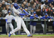 Kansas City Royals' Whit Merrifield connects for a three-run home run against the Seattle Mariners during the fourth inning of a baseball game Tuesday, June 18, 2019, in Seattle. (AP Photo/Elaine Thompson)