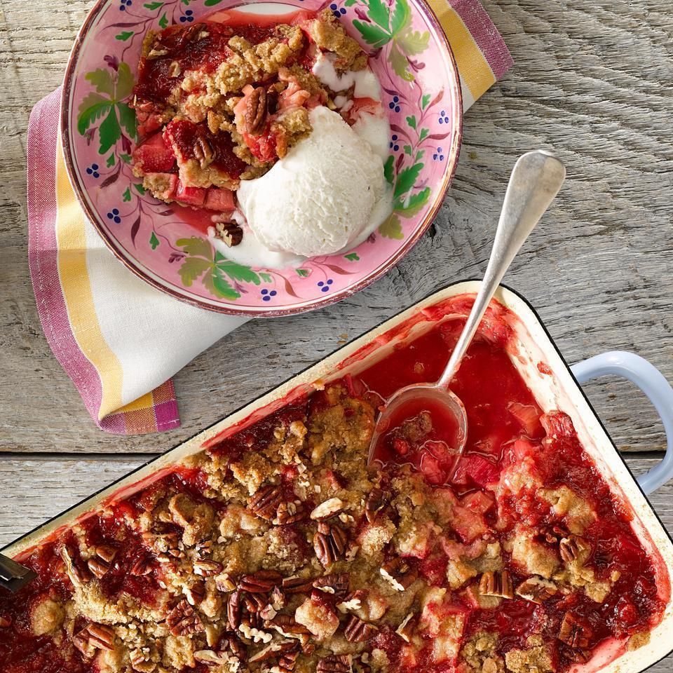 """<p>Rhubarb is a tangy counterpart for sweet raspberries in this fruit crumble recipe. For a nutty flavor and a boost of nutrition, this healthy dessert uses whole-grain rye flour and toasted pecans. Serve the crumble with your favorite vanilla frozen yogurt or a dollop of whipped cream. <a href=""""http://www.eatingwell.com/recipe/251144/rhubarb-raspberry-crumble/"""" rel=""""nofollow noopener"""" target=""""_blank"""" data-ylk=""""slk:View recipe"""" class=""""link rapid-noclick-resp""""> View recipe </a></p>"""