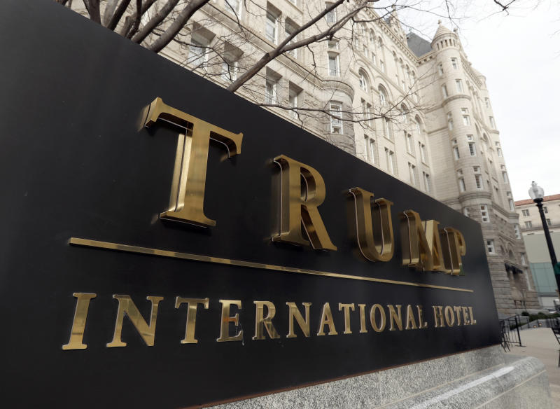 FILE - In this Dec. 21, 2016, file photo, The Trump International Hotel at 1100 Pennsylvania Avenue NW, is photographed in Washington. President Donald Trump has ripped up the playbook on avoiding conflicts of interest, and ethics experts are outraged. (AP Photo/Alex Brandon, File)